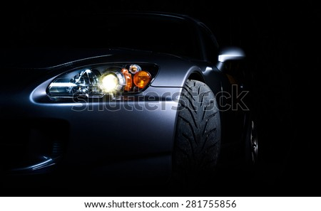 Front of a sports car - stock photo
