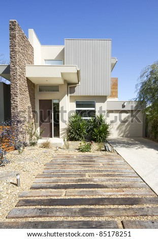 Front of a two storey contemporary architect designed townhouse home vertical format - stock photo