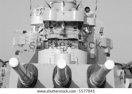 Front of a WWII battleship showing the 3 massive guns. - stock photo