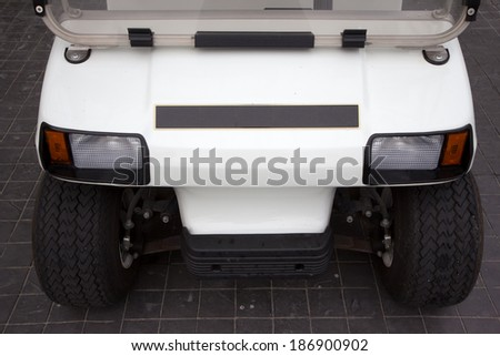 front of golf cart parked in the garage - stock photo