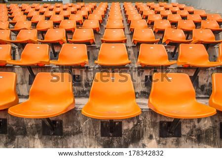 Front of the orange seats on the stadium - stock photo