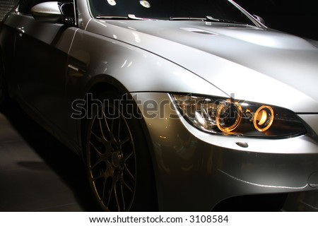 Front part of a coupe sports car. No logo shown. - stock photo