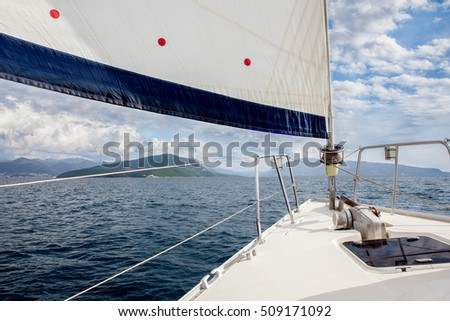 Front part of a sailboat, on full sails in Ionian sea