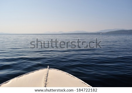 Front part of white ship with waves on adriatic sea. Suitable as marine background