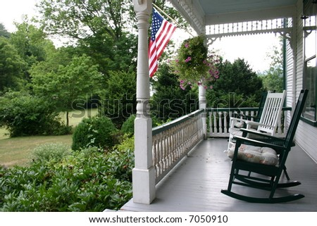 Front Porch on an Old Country House - Bed & Breakfast - stock photo