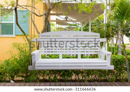 Front porch with a white porch swing