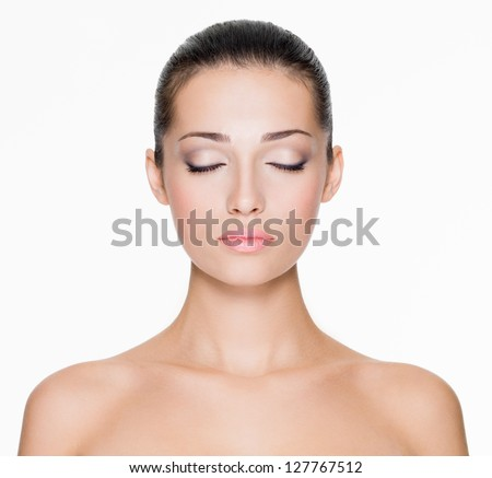 Front portrait of beautiful face with beautiful closed eyes - isolated on white - stock photo