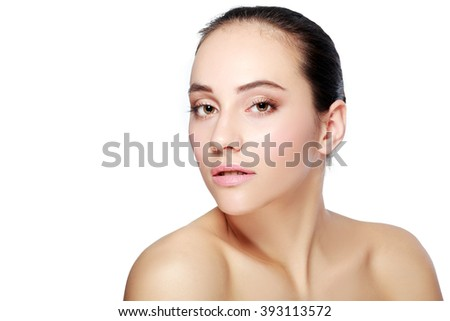 Front portrait of the woman with beauty face and hands and glowing skin - isolated on white