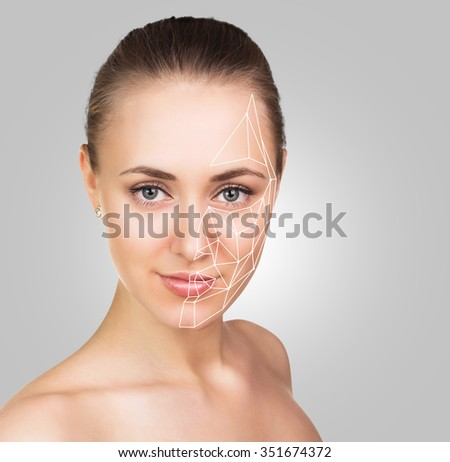 Front portrait of the woman with beauty face on the gray background - stock photo