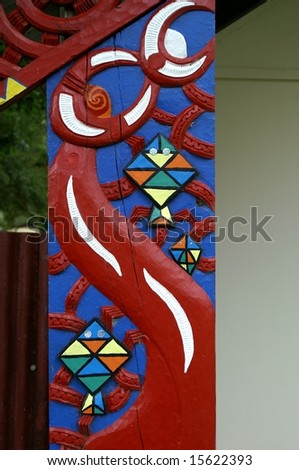 Front post of a traditional Maori Meeting House, New Zealand - stock photo