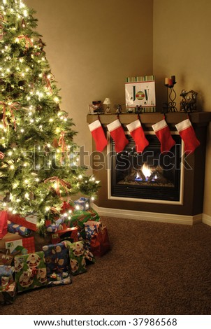 Front room decorated for christmas with christmas tree stockings and fireplace - stock photo