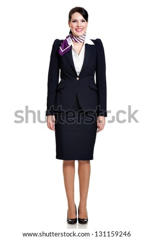 front side, full body of a beautiful dark haired young business woman dressed in a dark blue suit with a purple scarf smiling, isolated on white background - stock photo