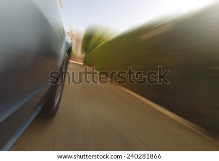 Front side view of a sport car in blurred motion - stock photo