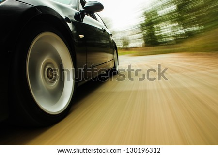 Front side view of black car. - stock photo
