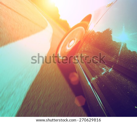 Front side view of the speeding car - stock photo