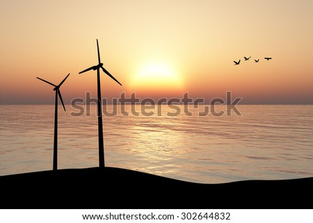 Front silhouette view of high windmill energy turbine on a hill inside lake or sea, on sunset or sunrise background.