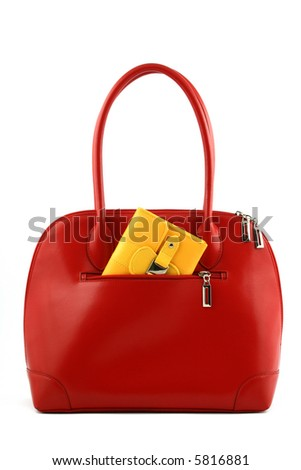 Front view at red handbag with yellow wallet in a pocket