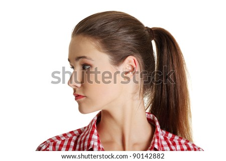 Front view face closeup portrait of a young female caucasian teen looking to the site, on white. - stock photo