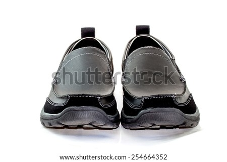 front view image of a pair of casual style black leather shoes on white background - stock photo