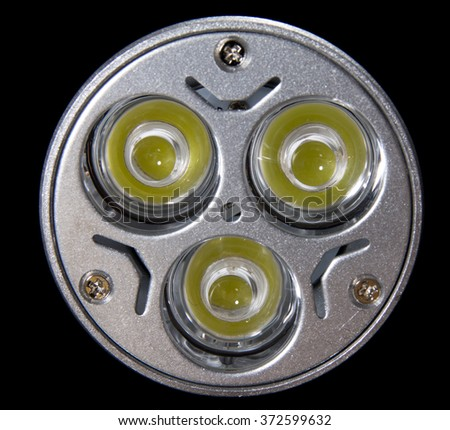 Front view LED bulb with 3 lenses and large diodes. Close up shot - stock photo