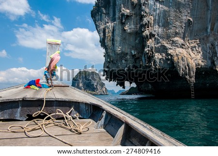 Front View Long tail boat at Krabi Islands sea Asia Thailand - stock photo