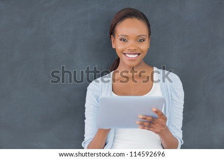 Front view of a black woman looking at camera in a classroom - stock photo