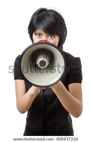 Front view of a business woman using a megaphone raised up to her mouth to be heard.