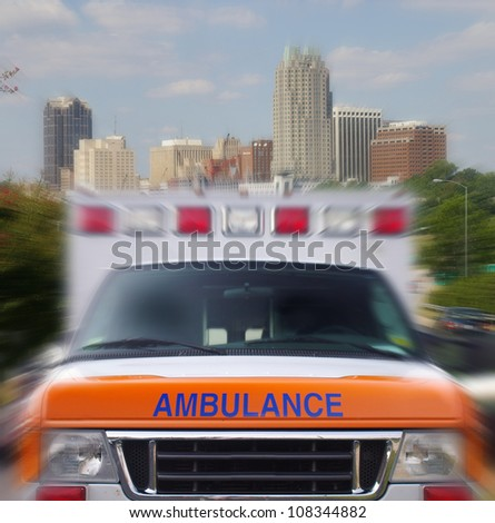 Front view of a city ambulance in motion - stock photo
