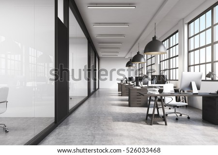 Front View Of A Long Office Room With Concrete Floor Tables Desktops And