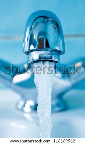 Front view of a modern water tap - stock photo