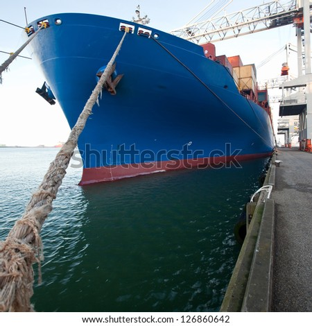 Front view of a moored container ship - stock photo