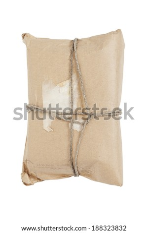 Front view of a post parcel  tied with a string, isolated on white  - stock photo