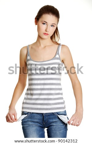 Front view of a sad young female caucasian teen taking out empty pockets, on white. - stock photo