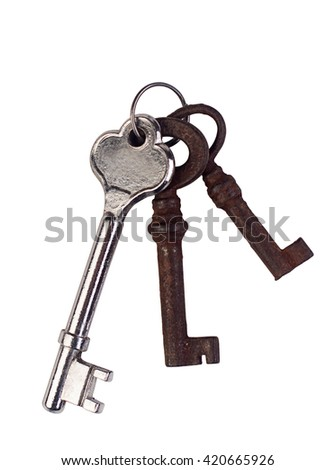 Front view of a silver key and two rusted ones isolated on white background