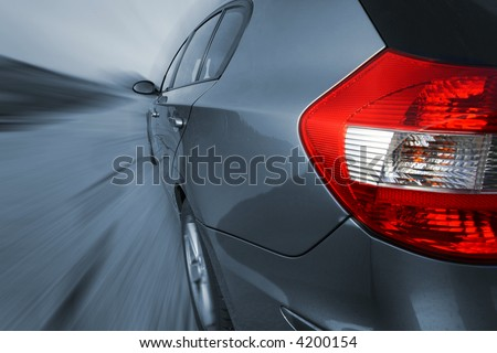 Front view of a sports car, shot with a wide angle lense. No logo shown. - stock photo