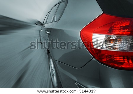 Front view of a sports vehicle, shot with a wide angle lense. No logo shown. - stock photo