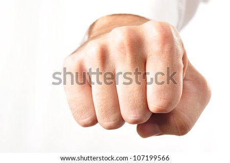 Front view of an isolated male fist with a white business shirt