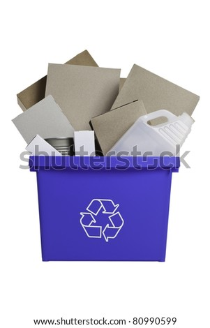 Front view of blue recycling bin isolated filled with empty plastic and glass bottles, empty cans and cardboard boxes. - stock photo