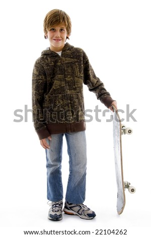 front view of boy holding skateboard against white background - stock photo