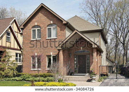 Front view of brick home in suburbs