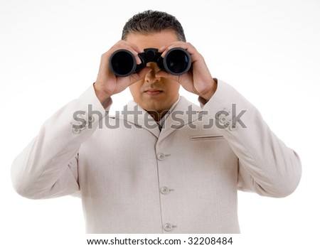front view of businessman looking through binocular on an isolated background - stock photo