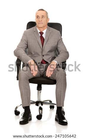 Front view of businessman sitting on armchair. - stock photo