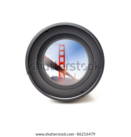 Front view of camera lens with desert landscape image reflection - stock photo
