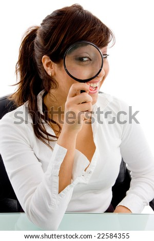 front view of female looking through lens against white background - stock photo