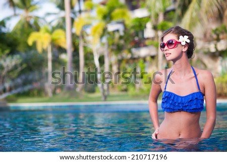 front view of fit woman in luxury spa pool - stock photo