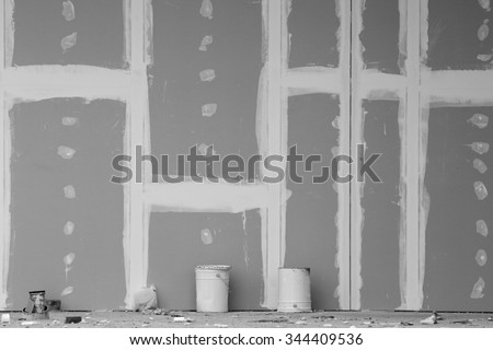 Front view of gypsum wall with joints at building site. Black and white image - stock photo