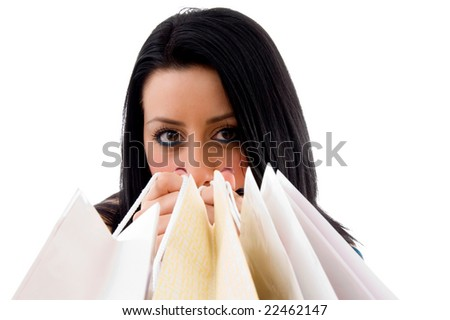 front view of model carrying shopping bags on an isolated background - stock photo