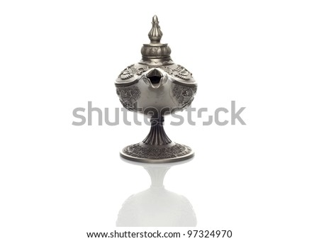 Front view of oil lamp east design with egypt or arabic texture with reflection on white background - stock photo