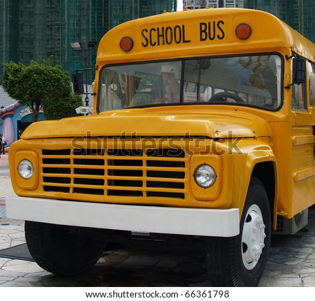 Front view of school bus - stock photo
