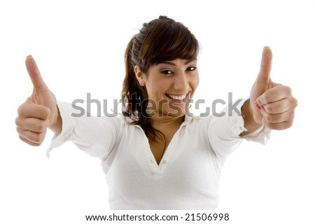 front view of smiling female executive with thumbs up against white background - stock photo